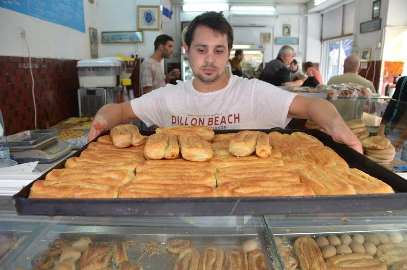 Yocahi Panso is a fourth-generation boureka baker. His family's store at Levinsky Market specializes in the savory Turkish pastry./Erez Kaganovitz